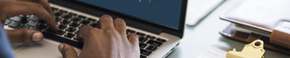 Black businessman using computer laptop